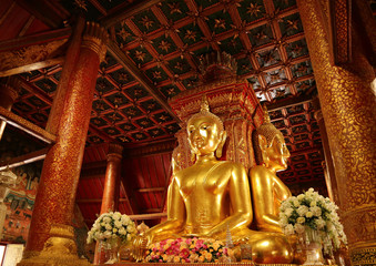 Unique and  Gorgeous Golden Four-sided Seated Buddha Images of Wat Phumin Temple, Famous Buddhist Temple in Nan Province, Thailand