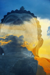 A peaceful superimposed or double exposure image of Sukhothai Buddha statue from Sukhothai Historical Park, Sukhothai, Thailand with beautiful clouds from Bangkok horizontal evening.