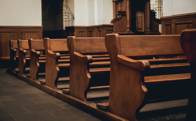 Rows of church benches. Selective focus.