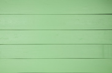 Green wooden background.