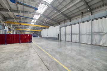Spacious factory shop. Interior of the industrial workshop