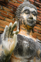 Old Buddha image selected focus on hand.