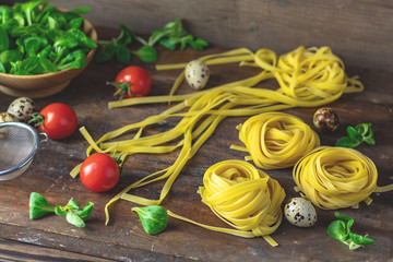 Raw homemade Italian typical pasta linguine noodles