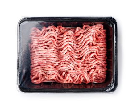 Plastic tray with raw fresh pork minced meat on white background. Packaging design for mock up.
