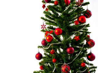 Big Christmas tree decorated with stars and beautiful red balls celebrate the festival.