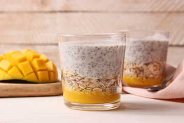 chia pudding with mango, granola and honey. Healthy dessert, proper nutrition, super food.