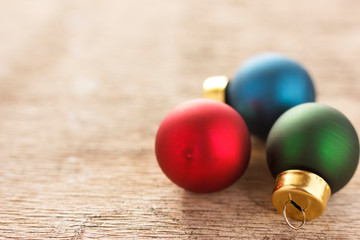 Christmas decoration. New year gifts and christmas tree balls on wooden background