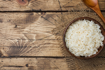 White boiled rice in a wooden bowl. Rustic style. Copy space