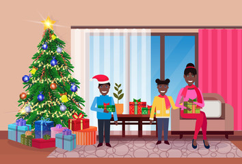 merry christmas happy new year family sitting living room pine tree home interior decoration winter holiday concept flat horizontal