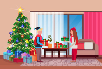 merry christmas happy new year couple give each other present gift box in living room pine tree home interior decoration winter holiday concept flat horizontal