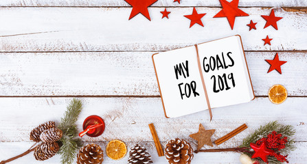 2019 goals in note pad in seasonal flat lay