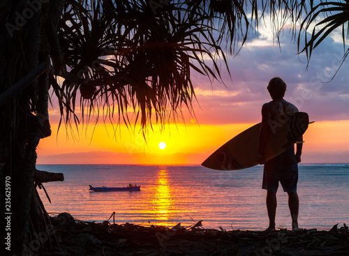 8534c22e20 surfer silhouette on tropical beach at sunset