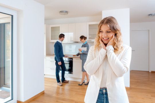 Woman raving about the apartment she and her man are going to rent or purchase