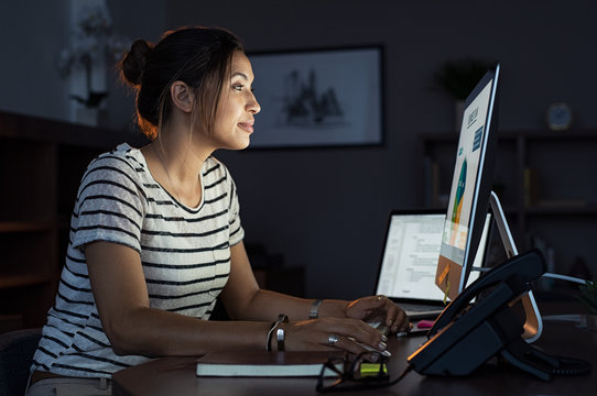 Casual woman working late at computer