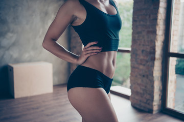 Cropped close-up belly thin graceful waist of stylish fitness mo