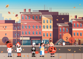 kids wearing monsters costumes walking town holiday concept cityscape background tricks or treat happy halloween cartoon character full length horizontal flat