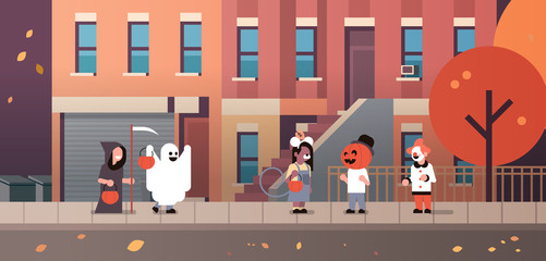 kids wearing monsters ghost pumpkin wizard clown costumes walking town holiday concept tricks or treat happy halloween cartoon character full length horizontal flat