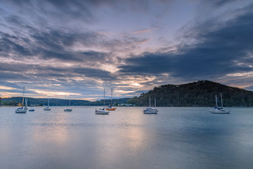 Cloudy Dawn on the Bay with Boats