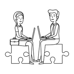 business couple sitting in puzzle piece with laptop
