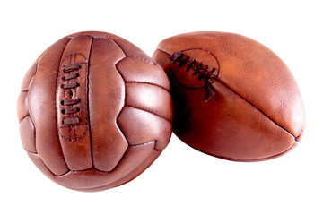 vintage soccer ball and rugby ball on white background
