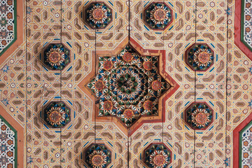 Ceiling art geometrically painted and sculpted