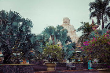 Massive statue of the Sitting Smiling Buddha at the Vinh Tranh Pagoda in My Tho, the Mekong Delta