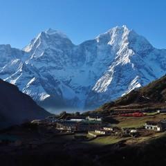 Small village Dole at sunrise. Snow capped mountains Kangtega and Thamserku. Gokyo Valley, Nepal.