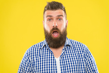 Man bearded hipster with sneezing face open eyes close up yellow background. Brutal hipster sneezing. Allergy concept. Take allergy medications. Can not stop sneezing. I am going to sneeze