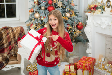 Just look at that. The morning before Xmas. Little girl. Happy new year. Winter. xmas online shopping. Family holiday. Christmas tree and presents. Child enjoy the holiday