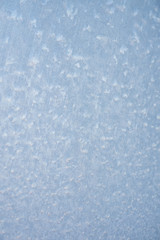 The patterns made by the frost on the window. Frosty winter background photo