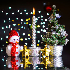 New Year and Christmas card with a candle and a snowman and a xmas tree