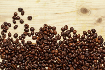 Close up of coffee beans on a wooden background