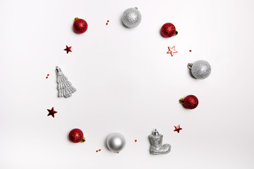 Christmas composition. Wreath of red balls, Santa's boot, Christmas tree and silver balls. Flat lay, top view