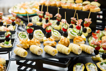 different types of catering canapes on buffet