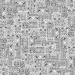 Seamless pattern of patchwork. Elegant ornament. Tribal and ethnic motifs. Black geometric elements on a white background. Vector illustration drawn by hand.