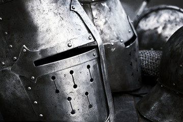 Steel medieval helmets with eyes slits side view. Black and white photo.
