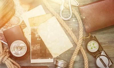 Traveler stuff on wooden table, vintage background