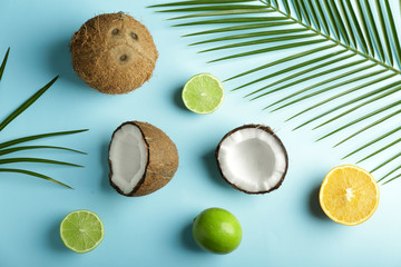 Ripe coconuts, lime and lemon on color background