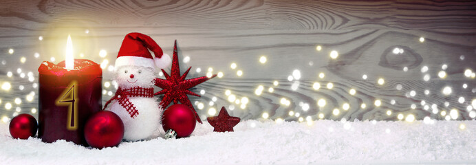 Christmas background with fourth Advent candle and Snowman with red decoration.