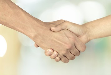 Business handshake of business people on background