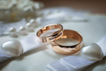 Two gold wedding rings close up Wall mural