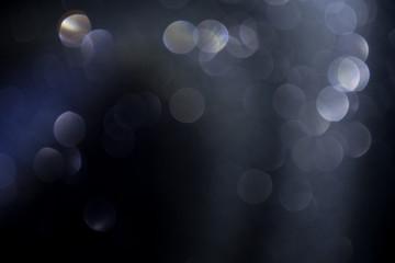 black spotlight shiny bokeh background.