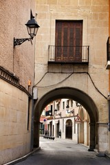 Narrow and colorful streets, facades and balconies in Elche city