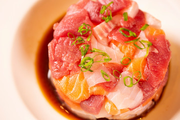 A delicious tartare of fresh Mediterranean tuna, salmon and white fish. Seasoned with extra virgin olive oil, chives, parsley and a drops of orange juice