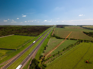Aerial view of the straight road along sugar cane field in Sao Paulo State, Brazil.
