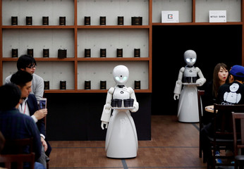 Remotely controlled robots OriHime-D serve customers at a cafe in Tokyo