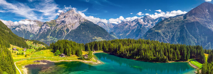Fotobehang Alpen Arnisee with Swiss Alps. Arnisee is a reservoir in the Canton of Uri, Switzerland, Europe