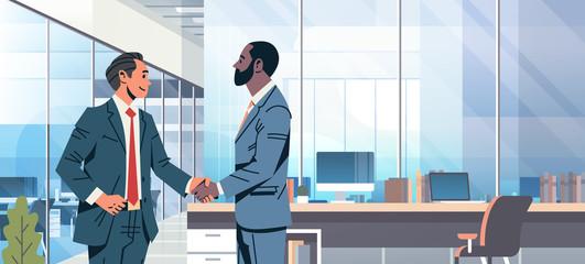 businessmen handshake agreement concept mix race business men partnership communication modern office interior male cartoon character flat portrait horizontal