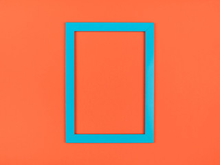 Empty picture frame on textured pastel colored background