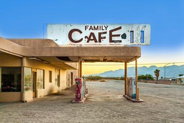 abandoned petrol station in the desert village of Desert Center in sunset
